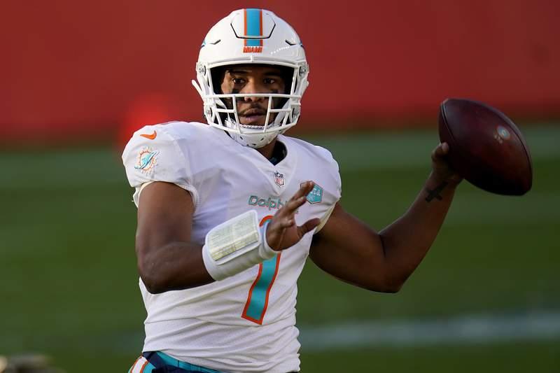 Miami Dolphins quarterback Tua Tagovailoa (1) looks to throw against the Denver Broncos during the first half of an NFL football game, Sunday, Nov. 22, 2020, in Denver. (AP Photo/David Zalubowski)