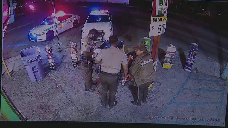 Police officers surround a 12-year-old boy after they said he was abducted, sexually assaulted and shot.