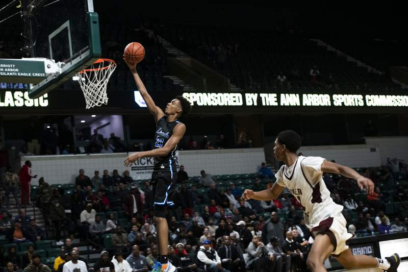FILE - In this Dec. 9, 2019, file photo, Ypsilanti Lincoln's Emoni Bates shoots against River Rouge during the Tip Off Classic high school basketball game in Ypsilanti, Mich. Michigan Associated Press Division I Player of the Year Emoni Bates does not appear interested in reclassifying to graduate from Ypsilanti Lincoln High School next year. The 6-foot-9 sophomore has been projected to potentially be taken No. 1 overall in the 2022 NBA Draft. (Nicole Hester/Ann Arbor News via AP, File)