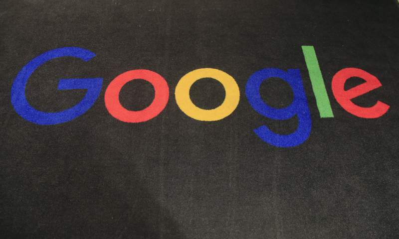FILE - In this Monday, Nov. 18, 2019 file photo, the logo of Google is displayed on a carpet at the entrance hall of Google France in Paris. On Thursday, Oct. 7, 2021 Ireland agreed to join an international agreement establishing a minimum corporate tax of 15% around the world, ditching the low-tax policy that has led companies like Google and Facebook to base their European operations in the country.  (AP Photo/Michel Euler, File)