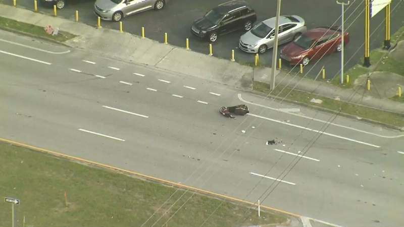 A man driving a scooter was killed in a two-vehicle crash on Colonial Drive in Orlando on Wednesday.