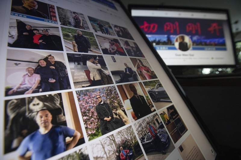 Facebook pages from Guo Wengui's account are seen on computer screens in Beijing on Friday, Aug. 21, 2020. The self-exiled Chinese tycoon on whose 150-foot (45-meter) yacht President Donald Trumps former chief strategist, Steve Bannon, was arrested is a high-profile irritant to the ruling Communist Party. In June, Guo and Bannon announced the founding of the Federal State of New China, an initiative to overthrow the Chinese government.  (AP Photo/Ng Han Guan)