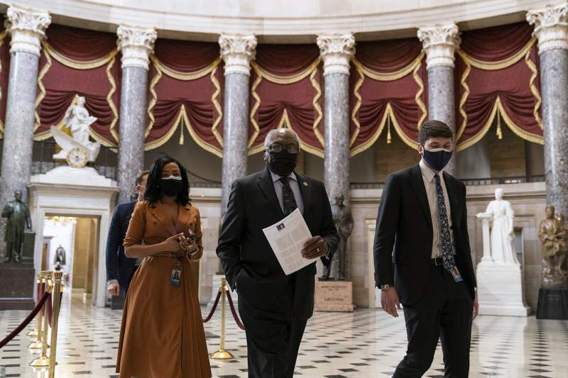 House Majority Whip James Clyburn of S.C., center, walks through Statuary Hall before the vote on the Democrat's $1.9 trillion COVID-19 relief bill, on Capitol Hill, Wednesday, March 10, 2021, in Washington. (AP Photo/Alex Brandon)