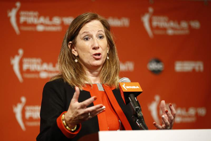 FILE - In this Sept. 29, 2019, file photo, WNBA Commissioner Cathy Engelbert speaks at a news conference before Game 1 of basketball's WNBA Finals between the Connecticut Sun and the Washington Mystics, in Washington. The WNBA has announced plans to play a reduced season, with a 22-game schedule that would begin in late July without fans in attendance. Theres a lot to do between now and the tip of the season, now that weve selected IMG Academy as the location to play, WNBA Commissioner Cathy Engelbert said in a phone interview Monday, June 15, 2020.  (AP Photo/Patrick Semansky, File)