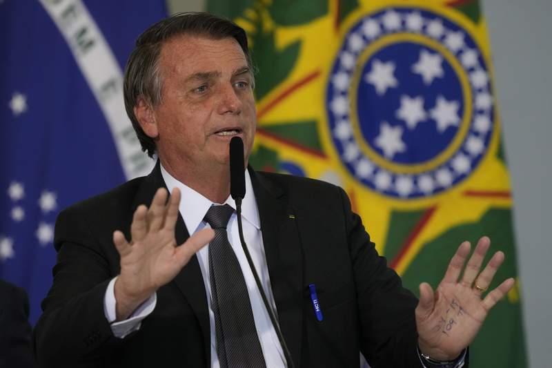 Brazil's President Jair Bolsonaro speaks during a ceremony at the Planalto presidential palace, in Brasilia, Brazil, Tuesday, July 13, 2021. (AP Photo/Eraldo Peres)