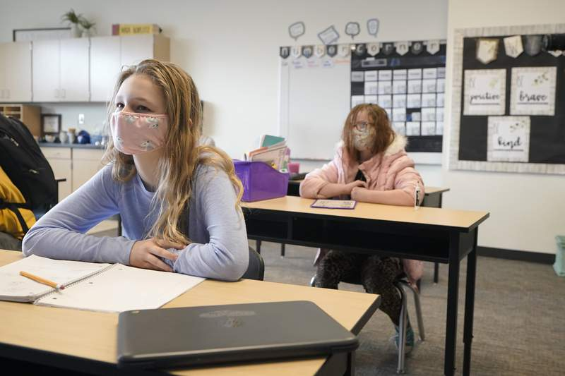 Students wear masks they work in a fourth-grade classroom, Tuesday, Feb. 2, 2021, at Elk Ridge Elementary School in Buckley, Wash.  (AP Photo/Ted S. Warren)