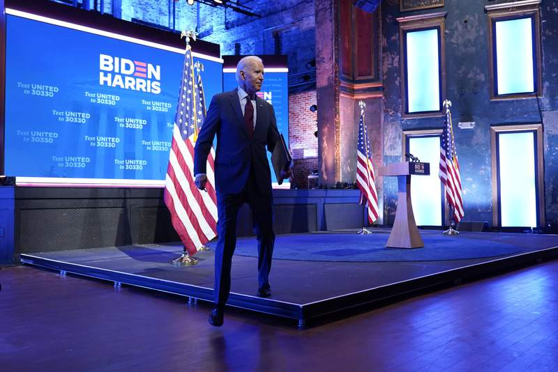 Democratic presidential candidate former Vice President Joe Biden walks off stage after giving a speech on the Supreme Court at The Queen Theater, Sunday, Sept. 27, 2020, in Wilmington, Del. (AP Photo/Andrew Harnik)