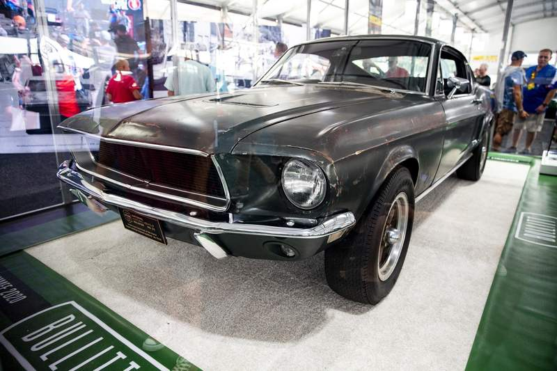 """A 1968 Ford Mustang GT named """"Bullitt,"""" from iconic 1968 film and driven by actor Steve McQueen is displayed at the Mecum Kissimmee 2020, Thursday, Jan. 9, 2020, in Kissimmee, Fla. The car could sell for millions at auction. The event is the world's largest collector car auction featuring 3,500 vehicles and goes through Jan. 12. (Patrick Connolly/Orlando Sentinel via AP)"""