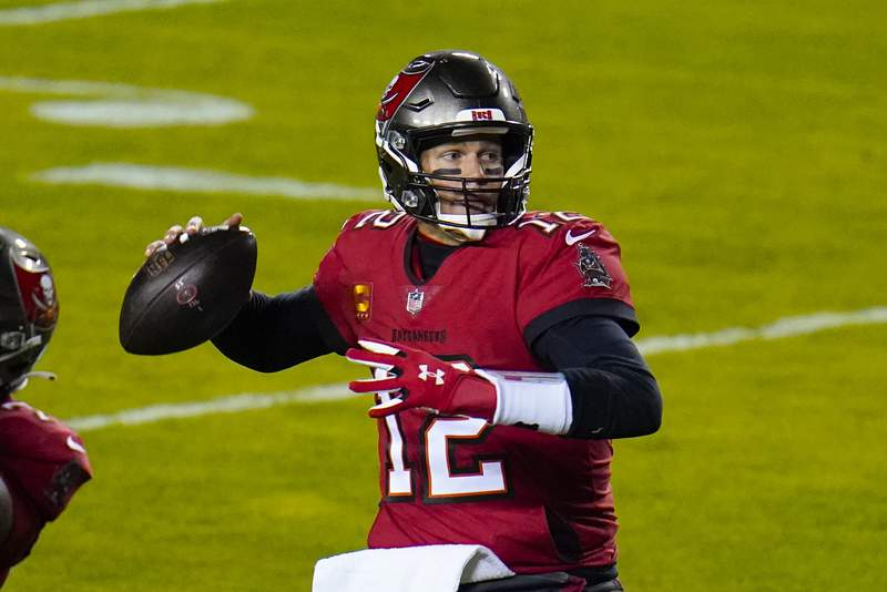 Tampa Bay Buccaneers quarterback Tom Brady (12) looks for a receiver during the first half of the team's NFL wild-card playoff football game against the Washington Football Team, Saturday, Jan. 9, 2021, in Landover, Md. (AP Photo/Julio Cortez)