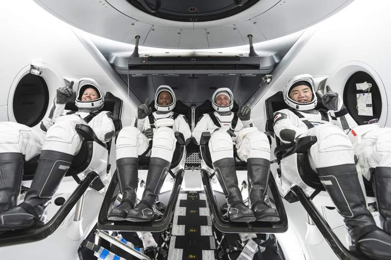 From left, Shannon Walker, Victor Glover, Michael Hopkins – all NASA astronauts – and Japan Aerospace Exploration Agency astronaut and Soichi Noguchi seated in SpaceX's Crew Dragon spacecraft during crew equipment interface training. (Image: NASA/SpaceX)