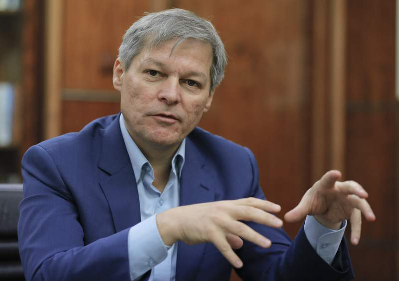 FILE - In this Friday, Dec. 9, 2016 file photo, Dacian Ciolos gestures during an interview with the Associated Press in Bucharest, Romania. Romania's president has nominated centrist party leader Dacian Ciolos to be prime minister after a protracted political crisis culminated last week in the Liberal-led coalition government being ousted in a no-confidence vote. After a day of deliberations Monday, Oct. 11, 2021 with Romanias political parties, President Klaus Iohannis nominated USR leader Ciolos to try to form a government. (AP Photo/Vadim Ghirda, file)