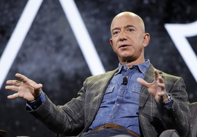 FILE - In this June 6, 2019 file photo, Amazon CEO Jeff Bezos speaks at the the Amazon re:MARS convention, in Las Vegas.   Bezos, who grew Amazon from an internet bookstore to an online shopping behemoth, said Wednesday, May 26, 2021,  that Amazon executive Andy Jassy will take over the CEO role on July 5.   (AP Photo/John Locher)