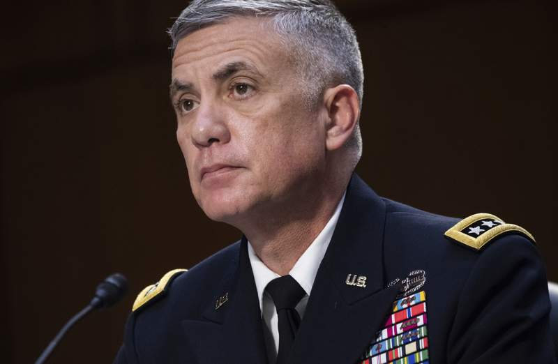 FILE - In this April 14, 2021, file photo National Security Agency (NSA) Director Gen. Paul Nakasone testifies during a Senate Select Committee on Intelligence hearing about worldwide threats, on Capitol Hill in Washington. Nakasone who leads U.S. efforts to thwart and punish foreign-based cyberattacks says hes mounting a new surge to fight incursions that have at times debilitated government agencies and companies responsible for critical infrastructure. In an interview, Nakasone broadly described an intense focus by government specialists to better find and share information about cyberattacks and impose costs when necessary. (Saul Loeb/Pool via AP, File)