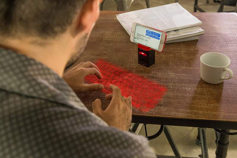 This keyboard uses advanced laser projection for you to turn any flat surface into a keyboard.