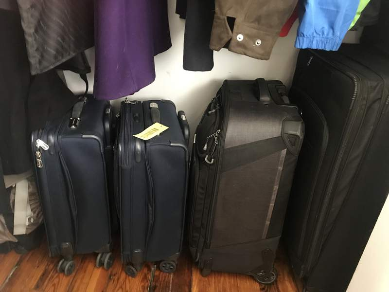Empty suitcases sit in Julie Paces closet in Washington, Tuesday, March 31, 2020. The suitcases, usually on the bedroom floor half-unpacked between trips, have been put away for now. (AP Photo/Julie Pace)