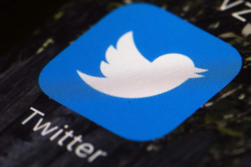 FILE - This April 26, 2017, file photo shows the Twitter app icon on a mobile phone in Philadelphia. Twitter announced Monday, May 11, 2020, it will warn users with a label when a tweet contains disputed or misleading information about the coronavirus. (AP Photo/Matt Rourke, File)
