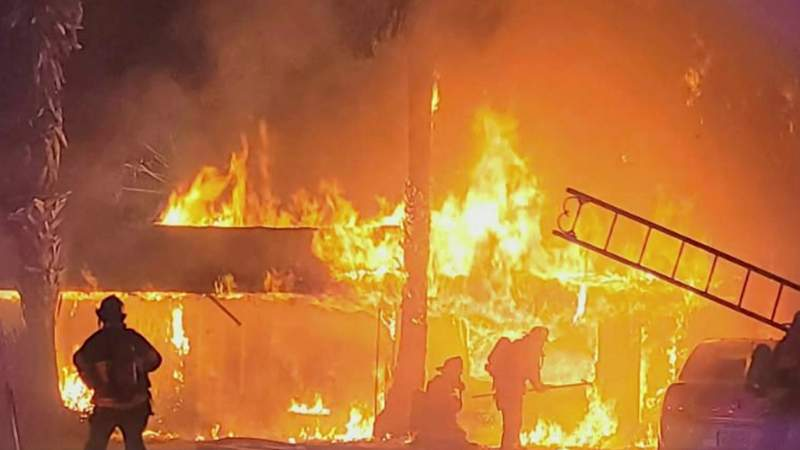 Marion firefighters save woman, dogs from motel blaze