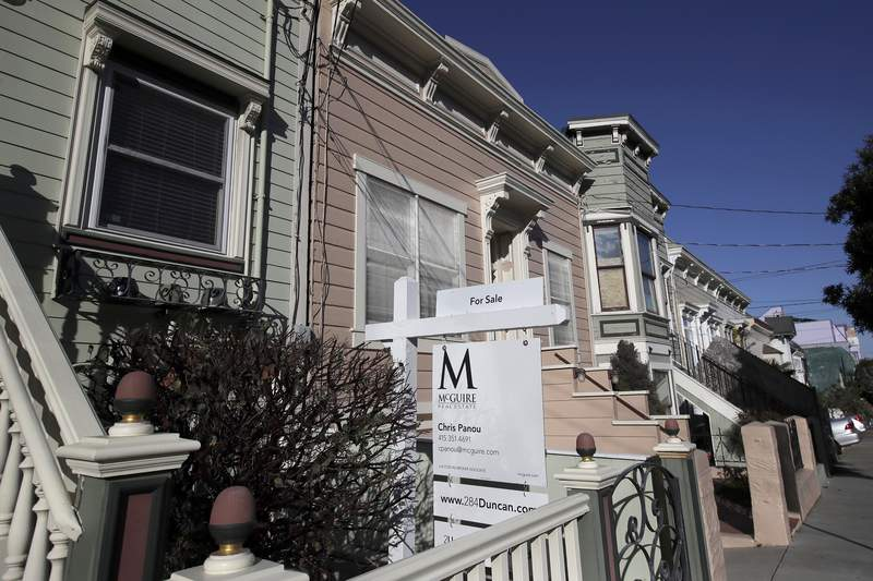 FILE - This Feb. 18, 2020, photo shows a real estate sign in front of a home for sale in San Francisco.  An estimated 4.1 million Americans have their mortgage in forbearance, according to data released Monday, May 18,  by the Mortgage Bankers Association.(AP Photo/Jeff Chiu, File)