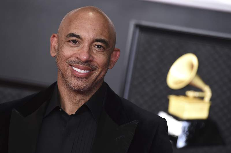 FILE - Harvey Mason Jr. arrives at the 63rd annual Grammy Awards on March 14, 2021. Mason Jr., was named the official president and CEO of The Recording Academy. The academy, which produces the Grammy Awards annually, made the announcement Thursday, May 13, 2021. (Photo by Jordan Strauss/Invision/AP, File)
