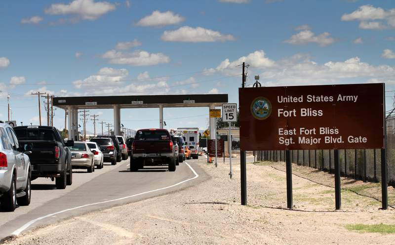 FILE - This Sept. 9, 2014 file photo shows cars wait to enter Fort Bliss in El Paso, Texas. The U.S. Army says eleven soldiers have been injured after ingesting an unknown substance during a field training exercise at Fort Bliss. A statement released late Thursday, Jan. 28, 2021, says two of the soldiers are in critical condition. (AP Photo/Juan Carlos Llorca, File)