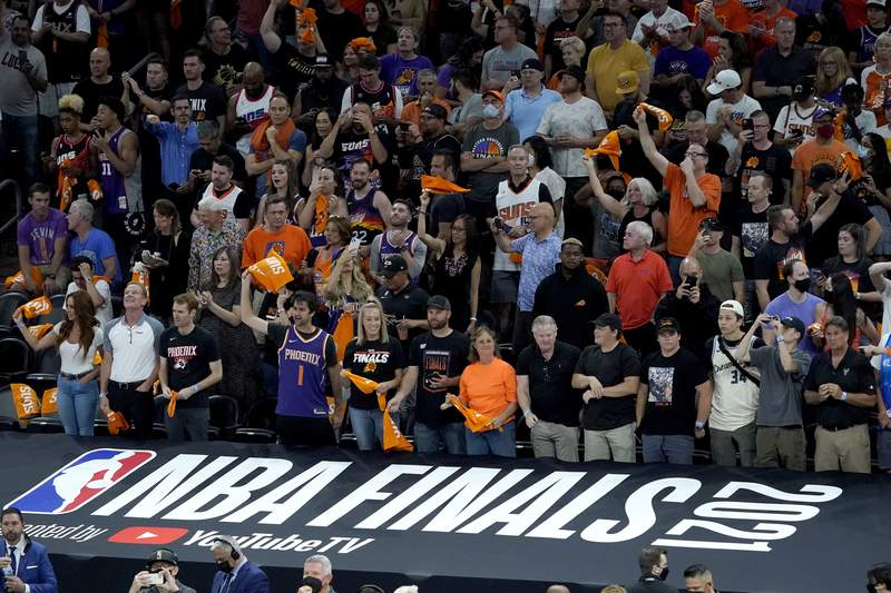 Fans cheer prior to game 1 of basketball's NBA Finals between the Milwaukee Bucks and the Phoenix Suns, Tuesday, July 6, 2021, in Phoenix. (AP Photo/Matt York, Pool)