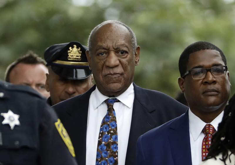 FILE - In this Sept. 24, 2018, file photo, Bill Cosby departs after a sentencing hearing at the Montgomery County Courthouse in Norristown, Pa. Legal advocates are lining up on both sides of actor Bill Cosbys appeal as the Pennsylvania Supreme Court prepares to review his 2018 sex assault conviction. (AP Photo/Matt Slocum, File)