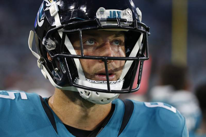 Jacksonville Jaguars tight end Tim Tebow paces the sideline during the first half of an NFL preseason football game against the Cleveland Browns, Saturday, Aug. 14, 2021, in Jacksonville, Fla. (AP Photo/Stephen B. Morton)