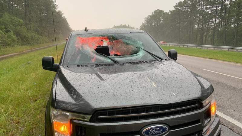 Pickup truck damaged by flying asphalt after lightning hit Interstate 10 in Walton County