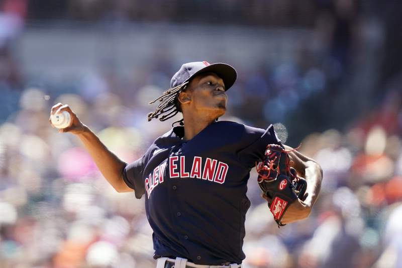 Cleveland Indians starting pitcher Triston McKenzie throws during the fourth inning of a baseball game against the Detroit Tigers, Sunday, Aug. 15, 2021, in Detroit. (AP Photo/Carlos Osorio)