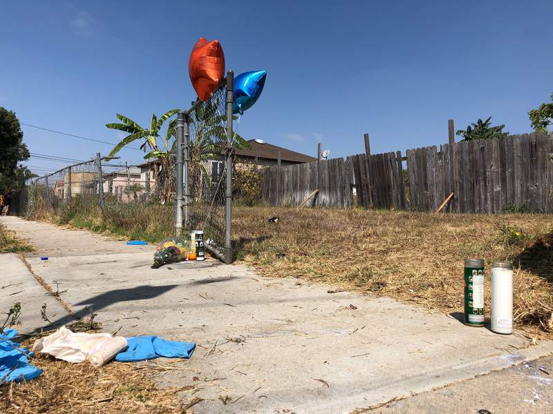 Balloons, candles and flowers are left on Tuesday, Sept. 1, 2020, as a memorial for Dijon Kizzee where he was fatally shot by Los Angeles sheriff's deputies the day before in the Westmont section of Los Angeles. Kizee, a Black man who deputies said was stopped for riding his bicycle in violation of vehicle codes, was fatally shot when he dropped a bundle of items that included a gun, authorities said, setting off a protest march to a nearby sheriff's station in Los Angeles. (AP Photo/Stefanie Dazio)