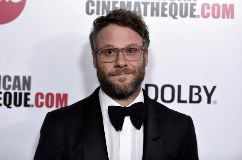 """FILE - Seth Rogen arrives at the 33rd American Cinematheque Award honoring Charlize Theron in Beverly Hills, Calif. on  Nov. 8, 2019. The actor, comedian, filmmaker and proud stoner has a deal with Crown for his first book. Its called Yearbook"""" and its scheduled for May 11.  (Photo by Richard Shotwell/Invision/AP, File)"""