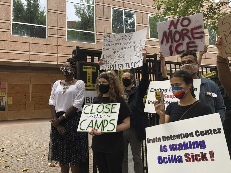 FILE - In this Tuesday, Sept. 15, 2020, file photo, Dawn Wooten, left, a nurse at Irwin County Detention Center in Ocilla, Georgia, speaks at a news conference in Atlanta protesting conditions at the immigration jail. Immigration authorities have stopped sending detained women at the Irwin County Detention Center to a rural Georgia gynecologist accused of performing surgeries without consent, a government spokesman said Tuesday, Sept. 22, 2020. (AP Photo/Jeff Amy, File)