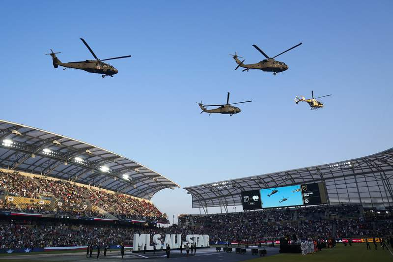 Helicopters fly over the field before the MLS All-Star soccer match Wednesday, Aug. 25, 2021, in Los Angeles. (AP Photo/Ashley Landis)