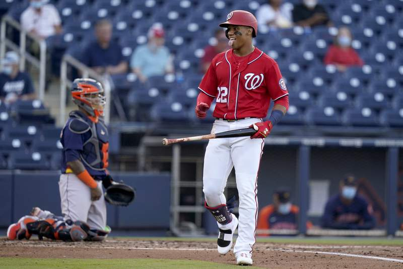 Washington Nationals' Juan Soto (22) reacts after drawing a walk during the second inning of a spring training baseball game against the Houston Astros, Wednesday, March 24, 2021, in West Palm Beach, Fla. (AP Photo/Lynne Sladky)