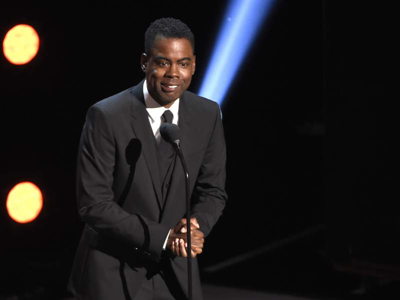 FILE - In this March 30, 2019 file photo, Chris Rock presents the award for outstanding comedy series at the 50th annual NAACP Image Awards at the Dolby Theatre in Los Angeles. Chris Rock on Sunday, Sept. 19, 2021 said he has been diagnosed with COVID-19 and sent a message to anyone still on the fence: Get vaccinated.  (Photo by Chris Pizzello/Invision/AP, File)