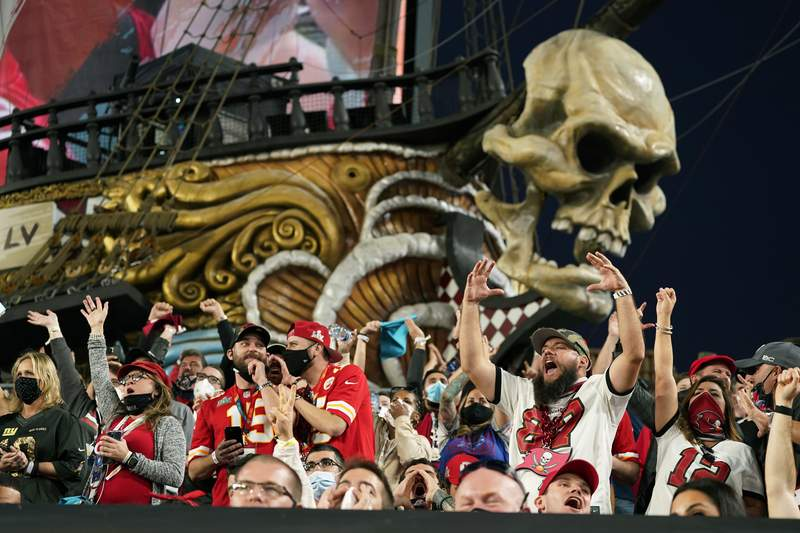 Fans cheer during the first half of the NFL Super Bowl 55 football game between the Tampa Bay Buccaneers and the Kansas City Chiefs, Sunday, Feb. 7, 2021, in Tampa, Fla. (AP Photo/Mark Humphrey)
