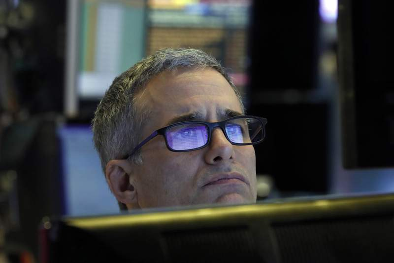 Specialist Anthony Rinaldi prepares for the day's trading, on the floor of the New York Stock Exchange, Thursday, March 5, 2020. (AP Photo/Richard Drew)