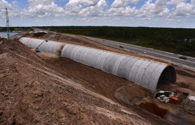 A 600-foot-long curved concrete structure is taking shape off State Road 528 near Canaveral Groves.