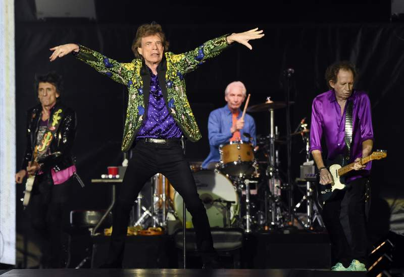 FILE - This Aug. 22, 2019 file photo shows, from left, Ron Wood, Mick Jagger, Charlie Watts and Keith Richards of the Rolling Stones performing in Pasadena, Calif. The band announced Thursday, Feb. 6, 2020, that they will kick off a 15-city leg of their No Filter tour beginning in May 2020 in San Diego. (Photo by Chris Pizzello/Invision/AP, File)