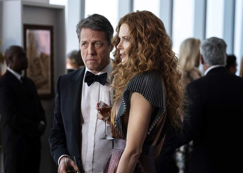 """This image released by HBO shows Hugh Grant, left, and Nicole Kidman in a scene from """"The Undoing."""" The Nielsen company said some three million people watched on Sunday to learn the mystery's resolution in the limited series. (HBO via AP)"""