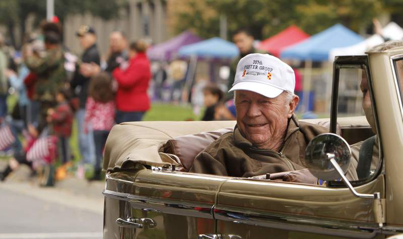Retired Air Force Brig. Gen. Chuck Yeager smiles to the crowd during the Veterans Day  parade in Sacramento, Calif. Friday Nov. 11, 2011.   Yeager, who was the first man to break the sound barrier, was the grand marshall of the parade.(AP Photo/Rich Pedroncelli)