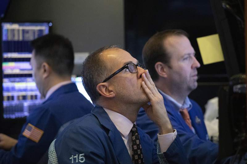 FILE - In this Jan. 2, 2020, file photo traders monitor stock prices at the New York Stock Exchange. The U.S. stock market opens at 9:30 a.m. EST on Thursday, Jan. 9. (AP Photo/Mark Lennihan, File)