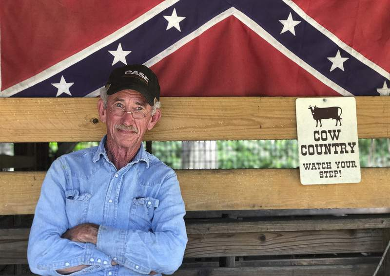 FILE - In this Tuesday, Aug. 15, 2017 file photo, Marion Lambert poses in Tampa, Fla. Authorities say Lambert, who spearheaded flying a massive Confederate flag at the corners of two busy Florida interstates, has died. Officers say they found the 73-year-old dead on his small farm in Tampa on Wednesday, Feb. 17, 2021. (AP Photo/Tamara Lush, File)