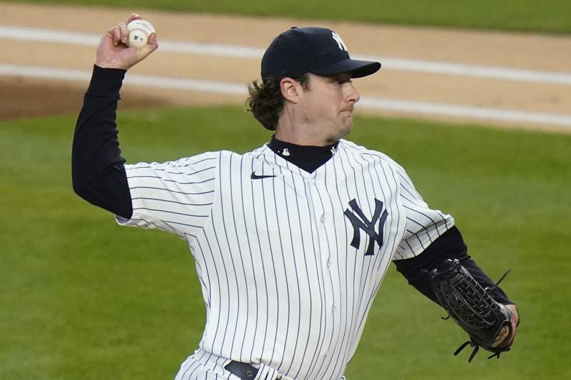 New York Yankees' Gerrit Cole delivers a pitch during the first inning of the team's baseball game against the Detroit Tigers Friday, April 30, 2021, in New York. (AP Photo/Frank Franklin II)