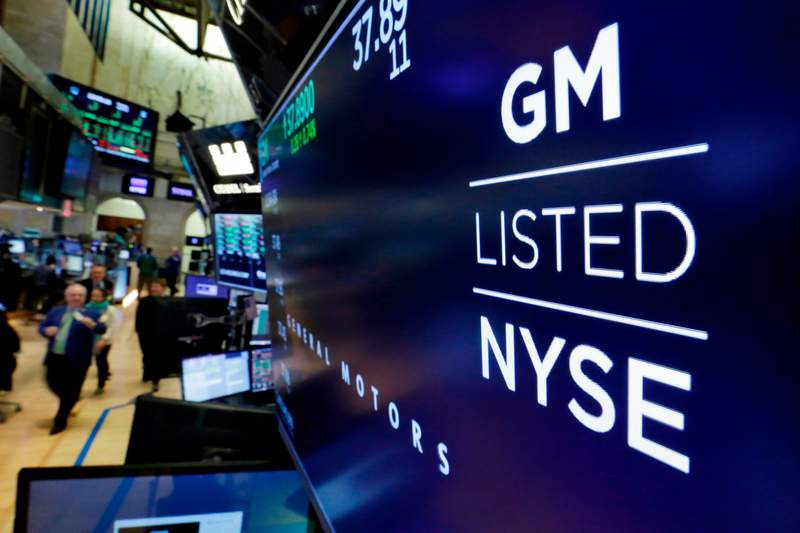 FILE- In this April 23, 2018, file photo, the logo for General Motors appears above a trading post on the floor of the New York Stock Exchange.  Even though General Motors was able to reopen its U.S. factories for the last half of the second quarter, the company still lost $806 million from April 2020 through June. The Detroit automaker had to close its plants from March 18 to May 18 due to the coronavirus, but production didnt resume fast enough to hold off a net loss. (AP Photo/Richard Drew, File)