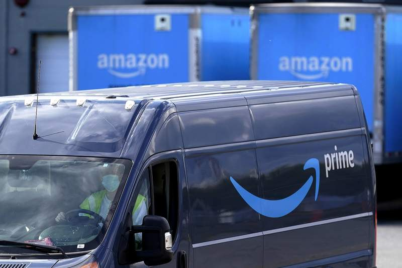 FILE - In this Oct. 1, 2020, file photo, an Amazon Prime logo appears on the side of a delivery van as it departs an Amazon Warehouse location in Dedham, Mass. Amazon announced Tuesday, Feb. 2, 2021, that Jeff Bezos would step down as CEO later in the year, leaving a role hes had since founding the company nearly 30 years ago. (AP Photo/Steven Senne, File)