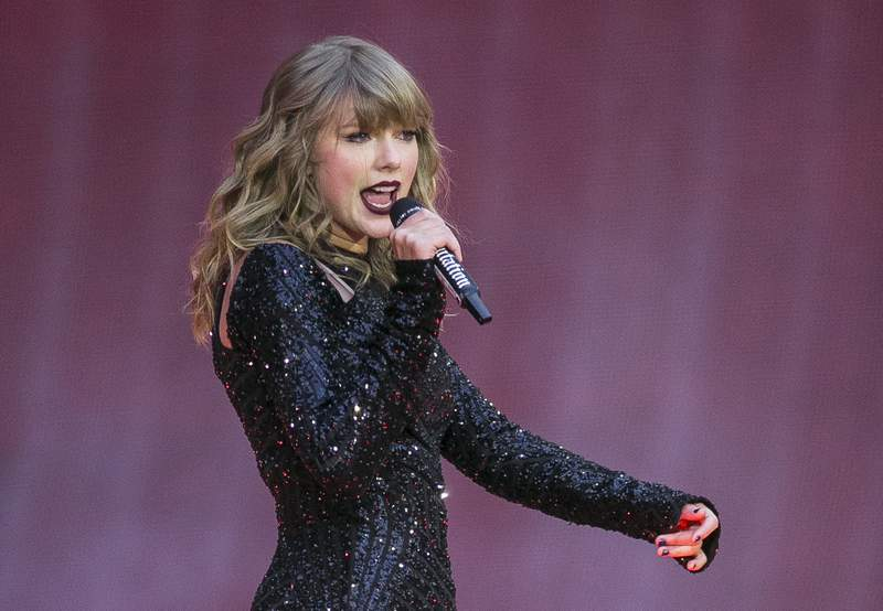 """FILE - In this June 22, 2018, file photo, singer Taylor Swift performs on stage in concert at Wembley Stadium in London. Swift is canceling all of her performances and appearances for the rest of the year because of the coronavirus pandemic. With many events throughout the world already cancelled, and upon direction from health officials in an effort to keep fans safe and help prevent the spread of COVID-19, sadly the decision has been made to cancel all Taylor Swift live appearances and performances this year,"""" Swifts representative said in a statement released Friday.  (Photo by Joel C Ryan/Invision/AP, File)"""