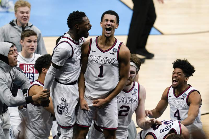 Gonzaga guard Jalen Suggs (1) celebrates making the game winning basket with Joel Ayayi, left, against UCLA during overtime in a men's Final Four NCAA college basketball tournament semifinal game, Saturday, April 3, 2021, at Lucas Oil Stadium in Indianapolis. Gonzaga won 93-90. (AP Photo/Michael Conroy)