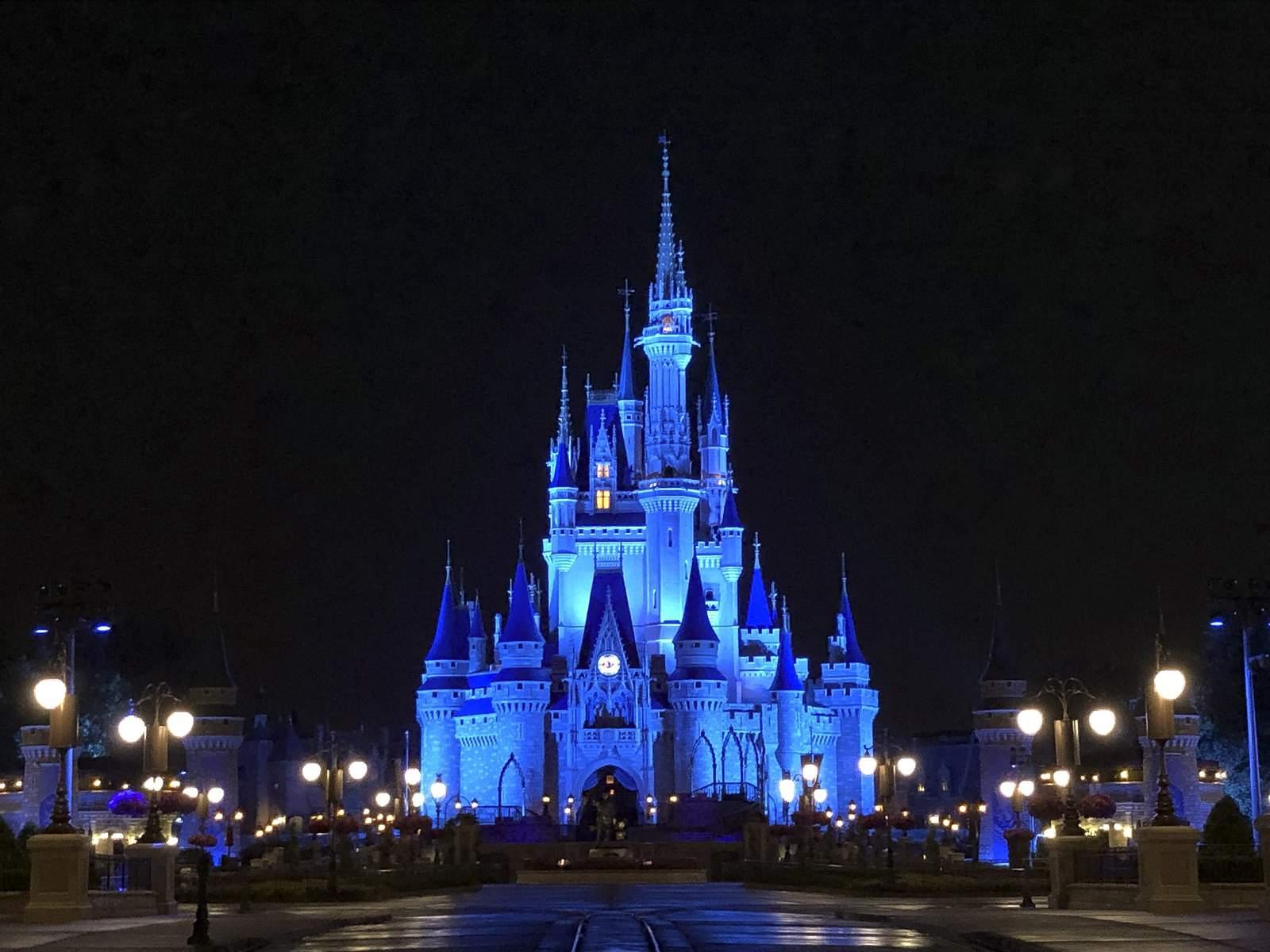 Castle Shines In Blue As Disney Parks