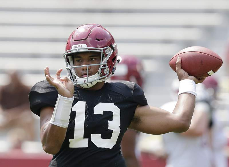 FILE - In this Aug. 5, 2017 file photo Alabama quarterback Tua Tagovailoa throws the ball during an NCAA college football practice at BryantDenny Stadium in Tuscaloosa, Ala. Tagovailoa signed a $30.275 million, four-year guaranteed contract with the Miami Dolphins, a person familiar with the negotiations confirmed Monday, May 11, 2020 to The Associated Press. (AP Photo/Brynn Anderson, file)